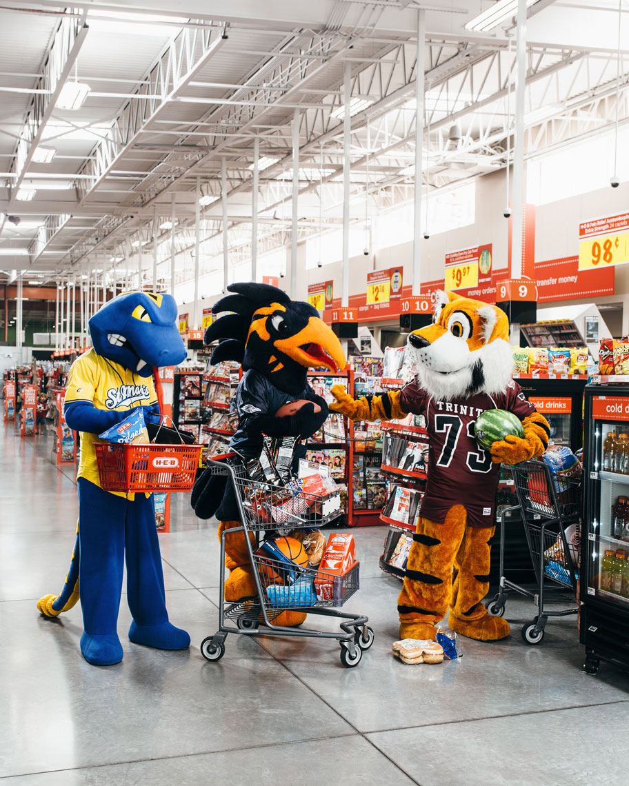 College Guide Cover at HEB with mascots from Trinity University, University of Texas at San Antonio, and St. Mary