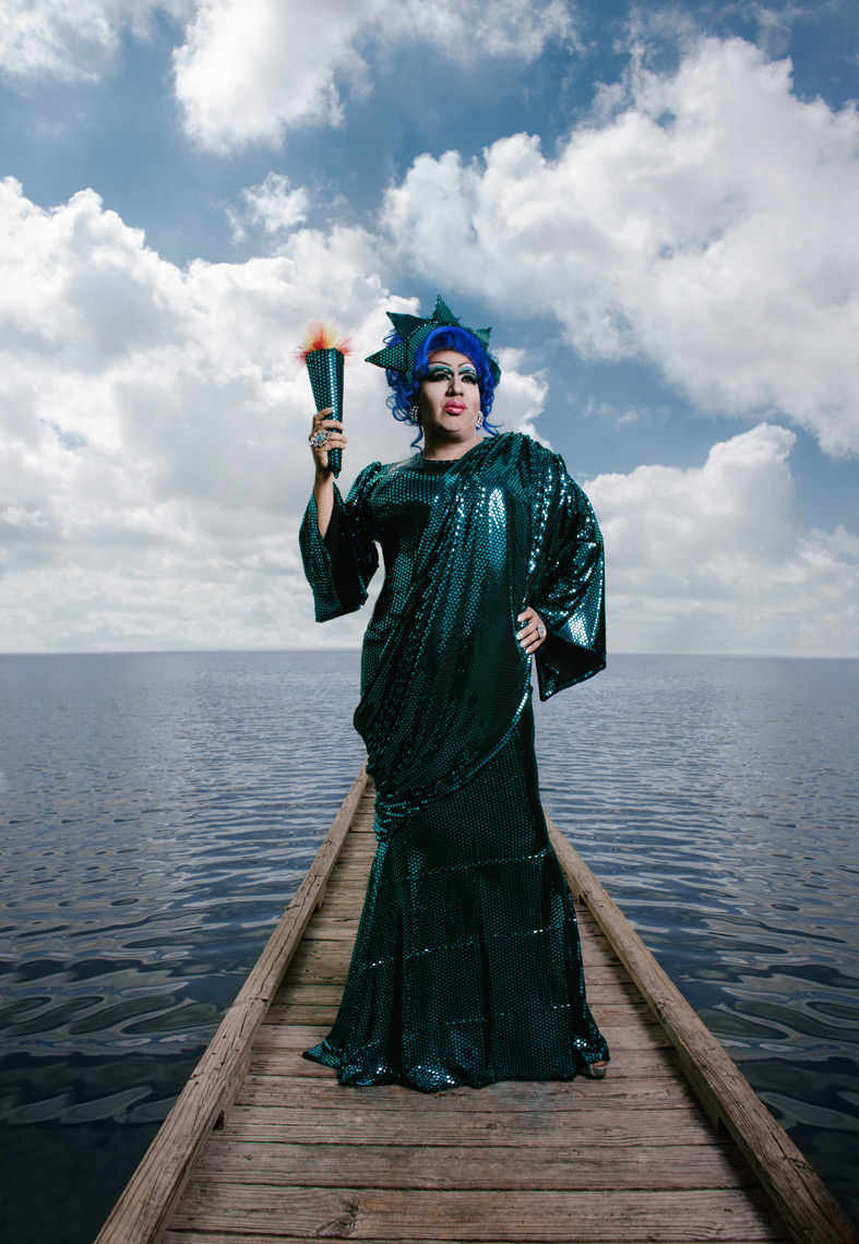 Lady Liberty photographed at Woodlawn Lake in San Antonio, TX, for the cover of The San Antonio Current, shot by Conceptual and Editorial Portrait photographer Josh Huskin.