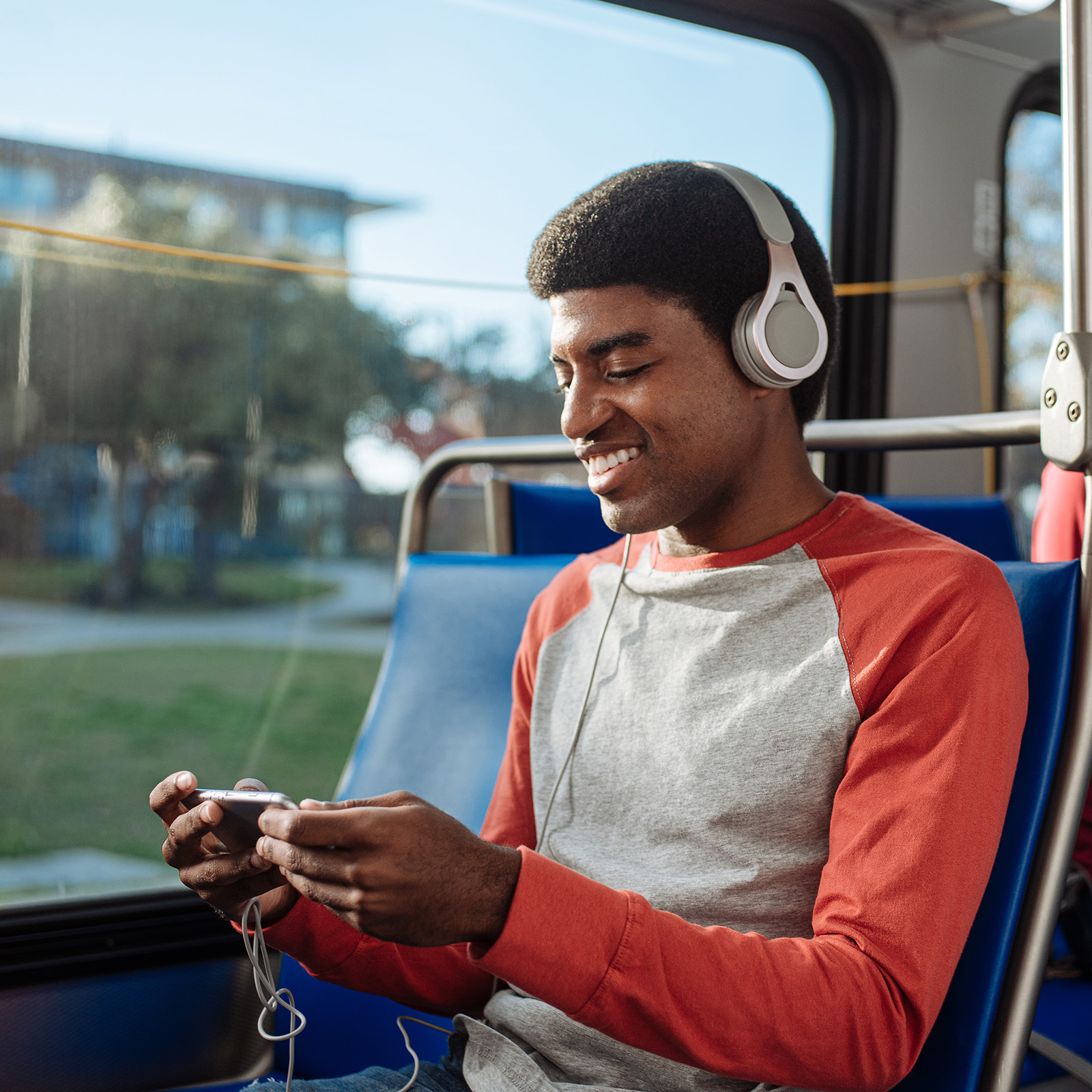 A rider smiles on a VIA bus in San Antonio, TX by commercial photographer Josh Huskin
