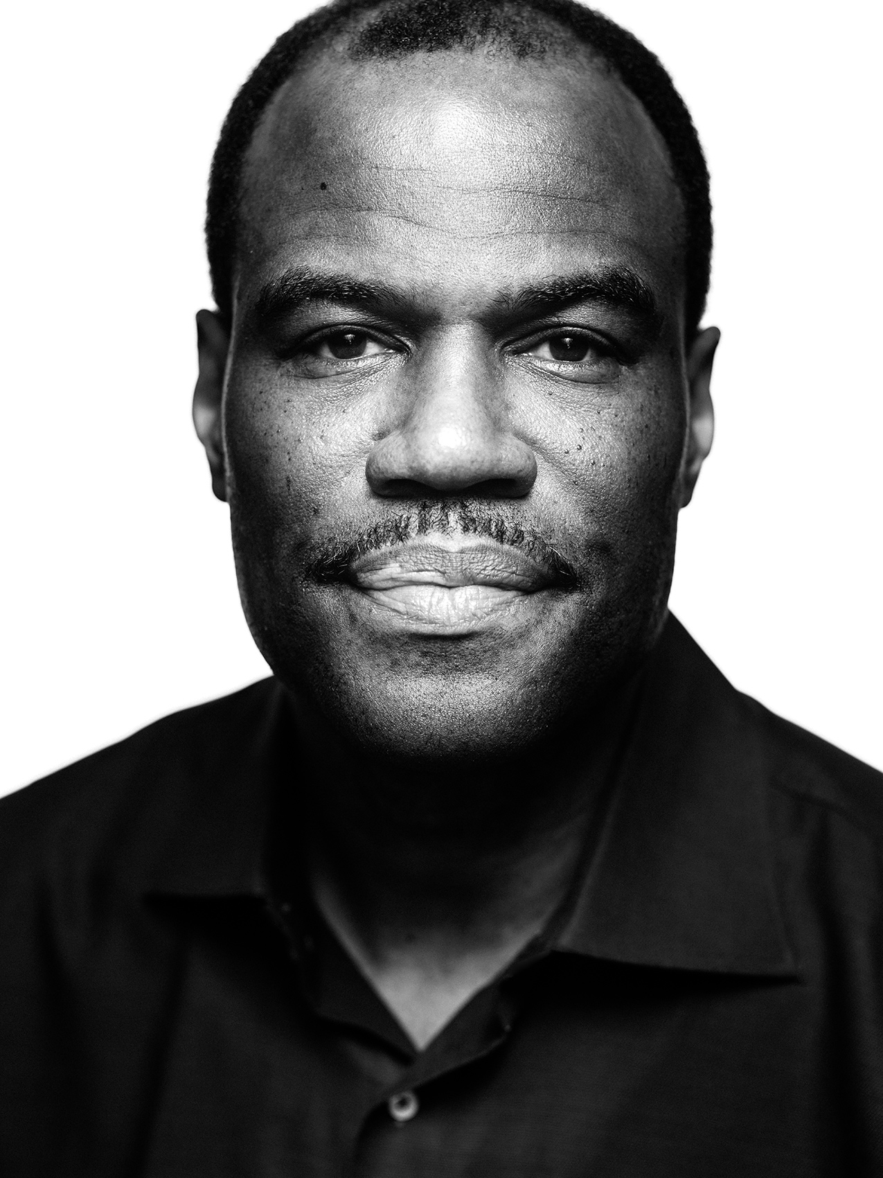 San Antonio Spurs and NBA legend, David Robinson, photographed in San Antonio, TX by sports portrait photographer, Josh Huskin.