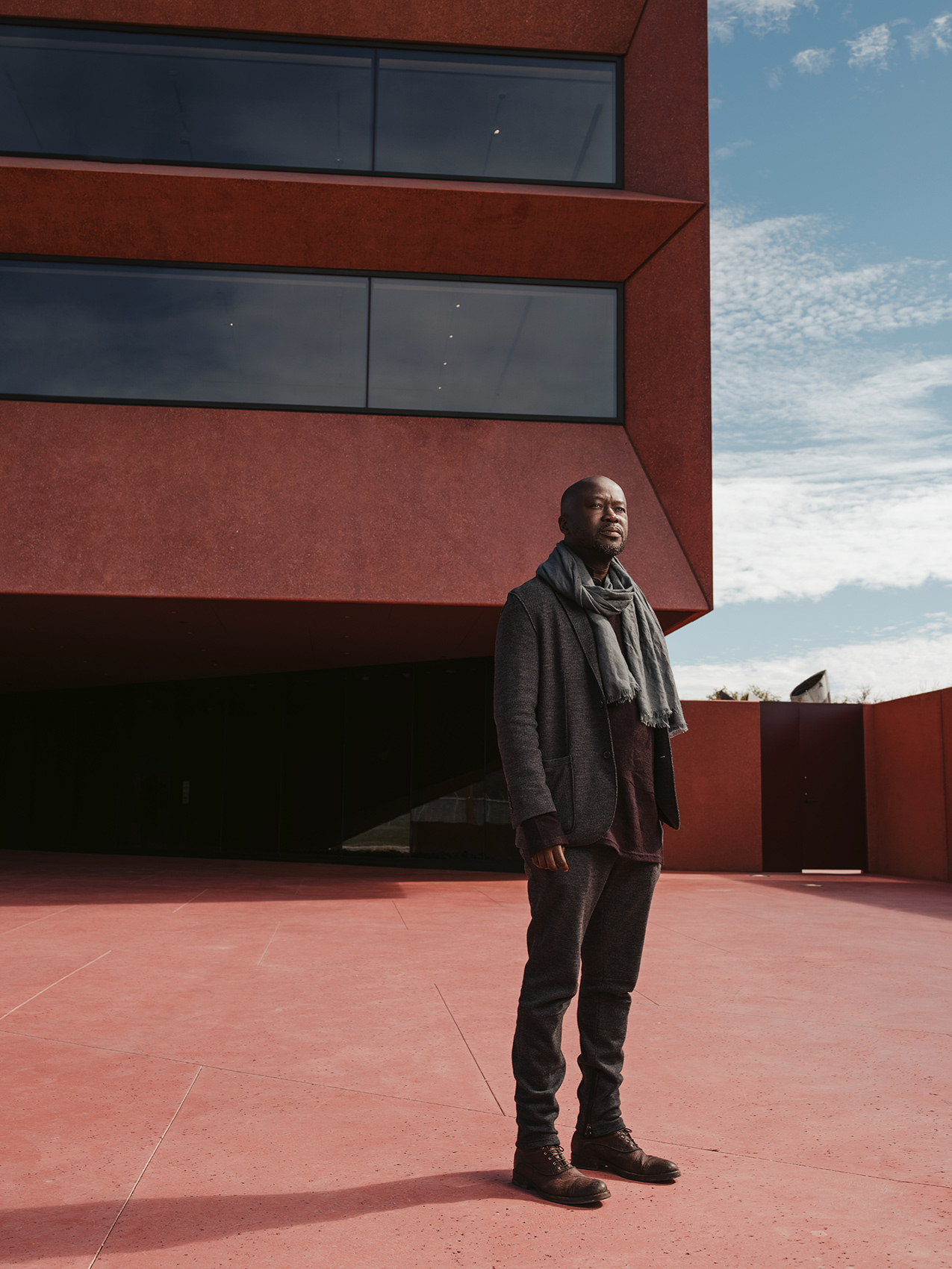 Sir David Adjaye photographed outside Ruby City in San Antonio, TX by portrait photographer Josh Huskin.